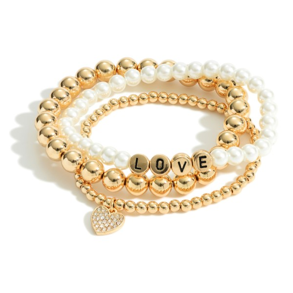 "Set of Three Beaded Stretch Bracelets Featuring Faux Pearl Accents, CZ Heart Pendant, and Metal Letter Beads that Spell ""Love"".   - Approximately 3"" in Diameter"