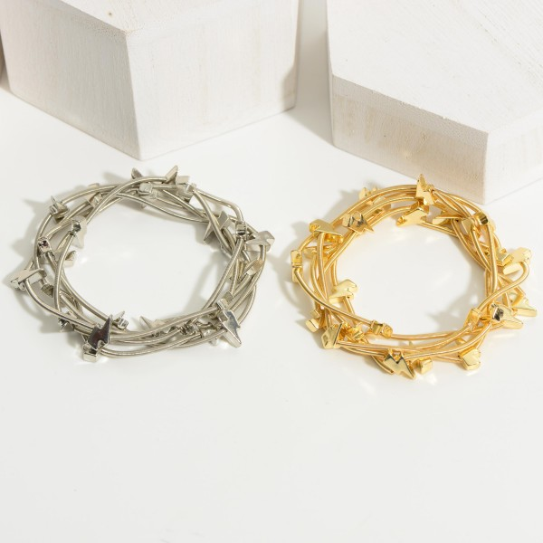 "Set of Five Metal Wire Bracelets Featuring Lightning Bolt Accents.   - Approximately 2.5"" in Diameter"