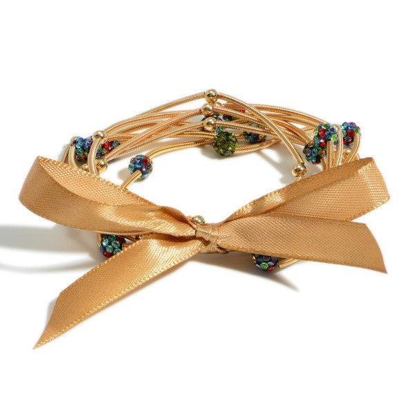 """Set of Eight Wire Bracelets Featuring Iridescent Bead Accents.   - Approximately 3"""" in Diameter"""