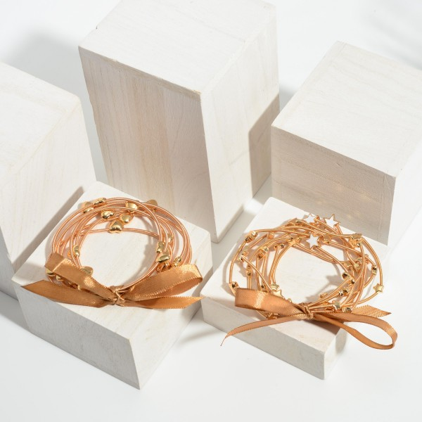 """Set of Six Wire Bracelets Featuring Star Accents.   - Approximately 3"""" in Diameter"""