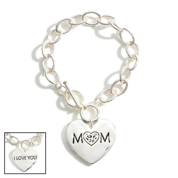 "Silver Chain Bracelet with Toggle Clasp Featuring Heart Shaped Pendant that Says ""Mom"".   - Approximately 3"" in Diameter"