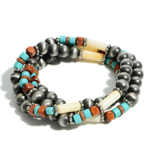 "Set of Three Beaded Stretch Bracelets Featuring Turquoise Accents.   - Approximately 3"" Long"
