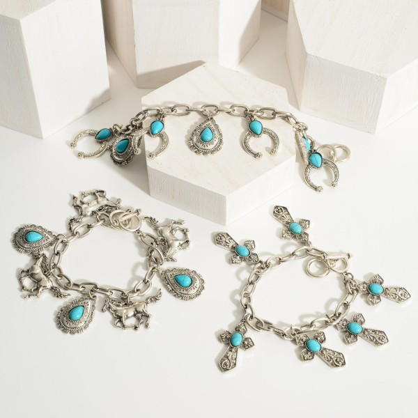 """Silver Charm Bracelet Featuring Cross Charms and Turquoise Accents.   - Approximately 2.5"""" in Diameter - Toggle Closure"""