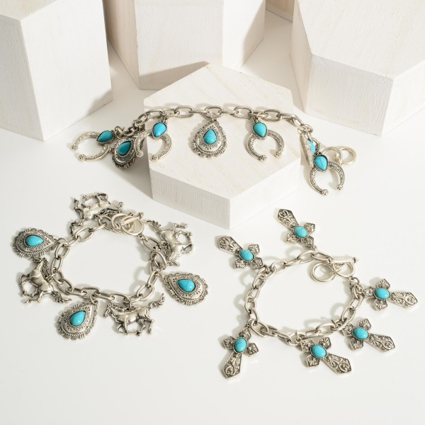 """Silver Charm Bracelet Featuring Horse Charms and Turquoise Accents.   - Approximately 2.5"""" in Diameter - Toggle Closure"""