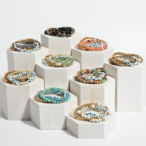 """Set of Five Bracelets Featuring Natural Stone Details, Iridescent Beads, and Evil Eye Accents.   - Approximately 3"""" in Diameter"""