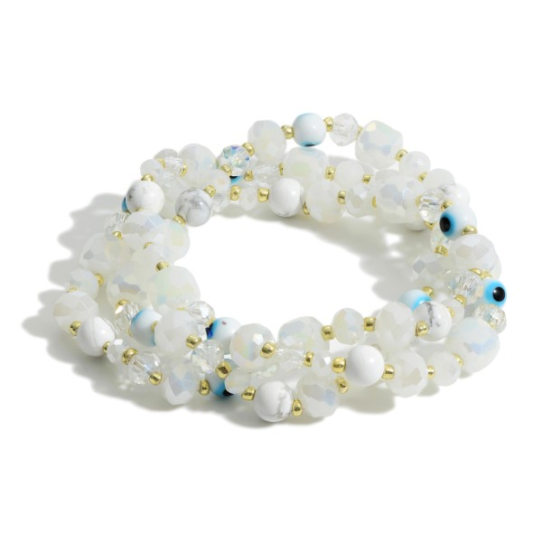 """Set of Three Bracelets Featuring Iridescent Beads and Evil Eye Accents.   - Approximately 3"""" in Diameter"""