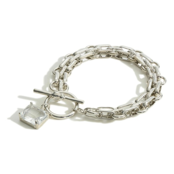"""Metal Chain Link Bracelet Featuring Clear Crystal Pendant and Toggle Closure.   - Approximately 3"""" in Diameter"""