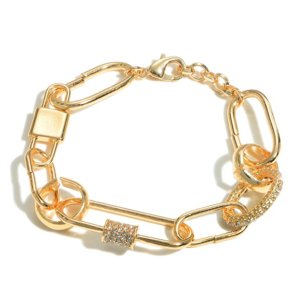"Gold Chain Link Bracelet Featuring Rhinestone Accents.   - Approximately 2.5"" Long  - Lobster Claw Clasp"