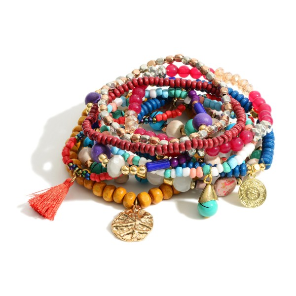 """Set of Ten Beaded Bracelets Featuring Gold Accents and Tassel Details.   - Approximately 3"""" in Diameter"""