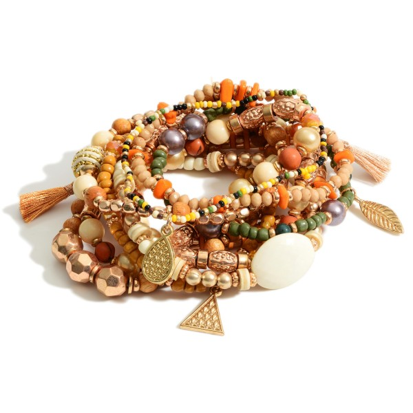 """Set of Ten Beaded Bracelets Featuring Gold Accents and Wood Details.   - Approximately 3"""" in Diameter"""