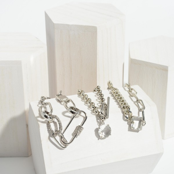 """Metal Chain Link Bracelet Featuring Clear Crystal Accents.   - Approximately 3"""" in Diameter"""
