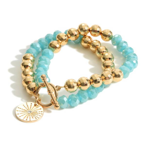 """Crystal Beaded Bracelet Featuring a Starburst Pendant.  - Approximately 2.5"""" Diameter - Toggle Closure"""