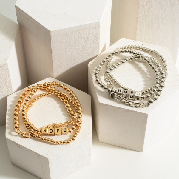 """Set of Three Metal Bracelets featuring Block Letters that Say """"Hope"""".  - Approximately 2.5"""" in Diameter"""