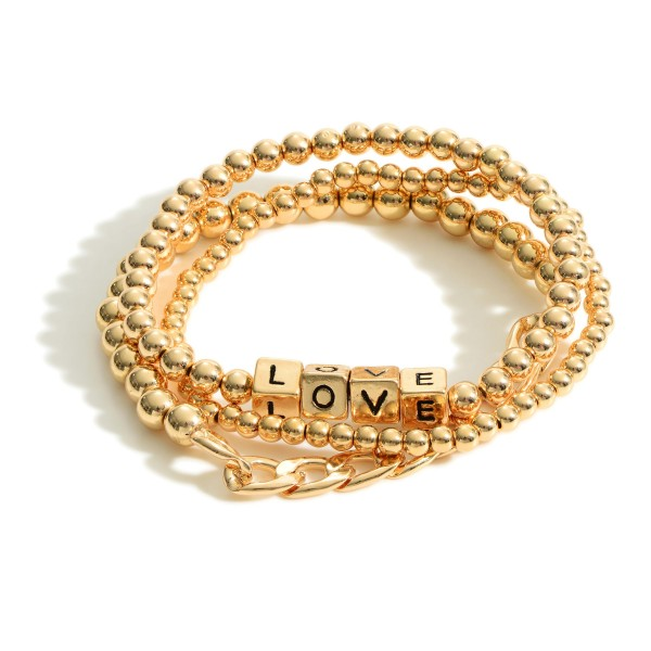 """Set of Three Metal Bracelets featuring Block Letters that Say """"Love"""".  - Approximately 2.5"""" in Diameter"""
