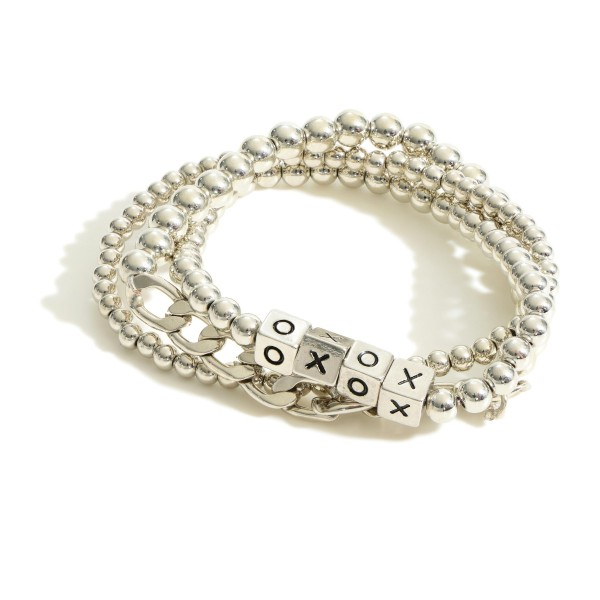 """Set of Three Metal Bracelets featuring Block Letters that Say """"XOXO"""".  - Approximately 2.5"""" in Diameter"""