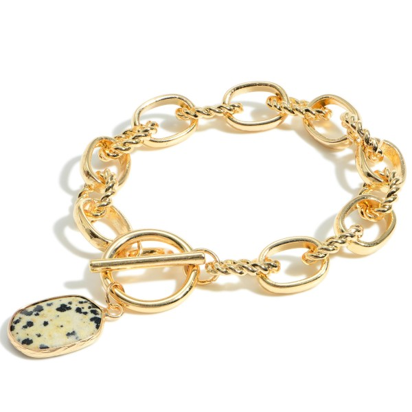 """Gold Chain Link Bracelet Featuring Toggle Closure and Natural Stone Pendant.   - Approximately 3"""" in Diameter"""