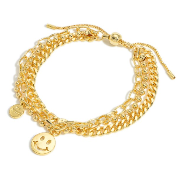 """Gold Layered Chain Link Bracelet featuring a Smiley Face Charm.  - Approximately 3"""" in Diameter - Adjustable Bolo Clasp"""