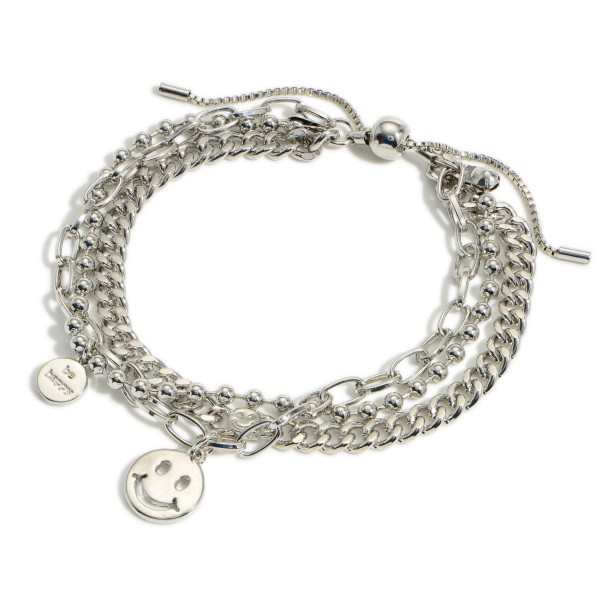 """Silver Layered Chain Link Bracelet featuring a Smiley Face Charm.  - Approximately 3"""" in Diameter - Adjustable Bolo Clasp"""