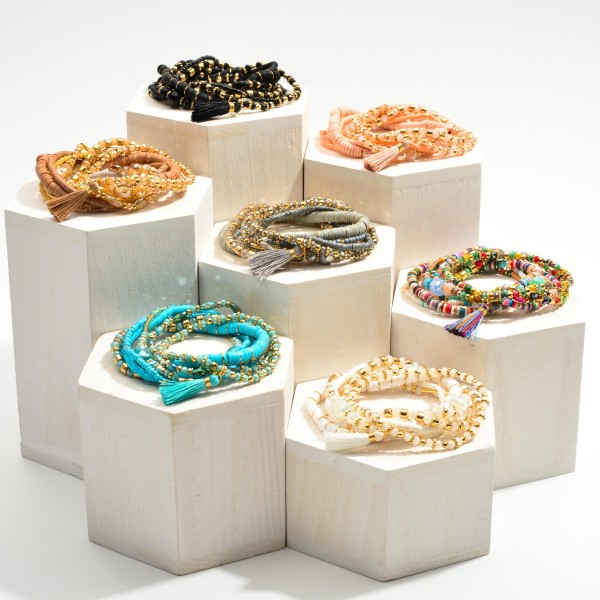 """Set of Seven Heishi Bead Bracelets Featuring Tassel Accents.  - Approximately 2.5"""" in Diameter"""