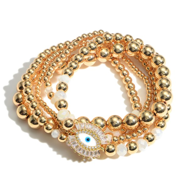 """Set of Four Gold Beaded Bracelets Featuring Evil Eye Accents.  - Approximately 2.5"""" in Diameter"""