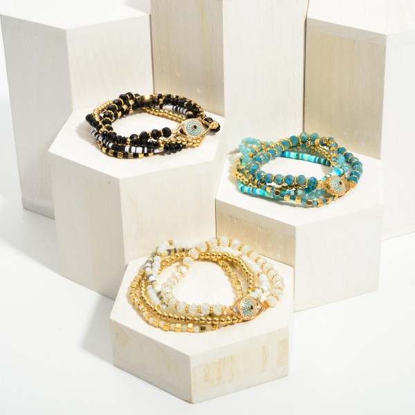"""Set of Three Heish Bead Bracelets Featuring CZ Evil Eye Accents.  - Approximately 2.5"""" in Diameter"""