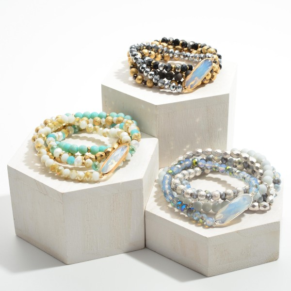 """Set of Five Beaded Bracelets Featuring Clear Stone Accent and Silver Details.   - Approximately 3"""" in Diameter"""
