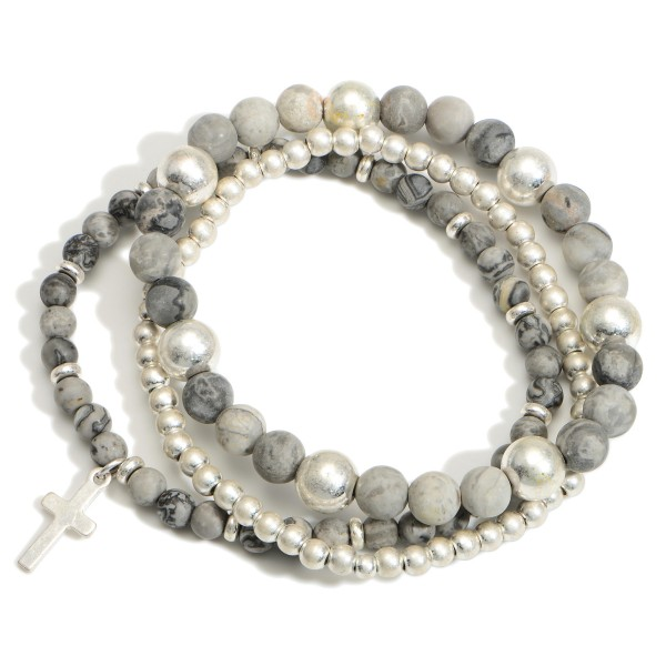 """Set of Three Beaded Bracelets Featuring a Cross Charm.   -  Approximately 2.5"""" in Diameter"""