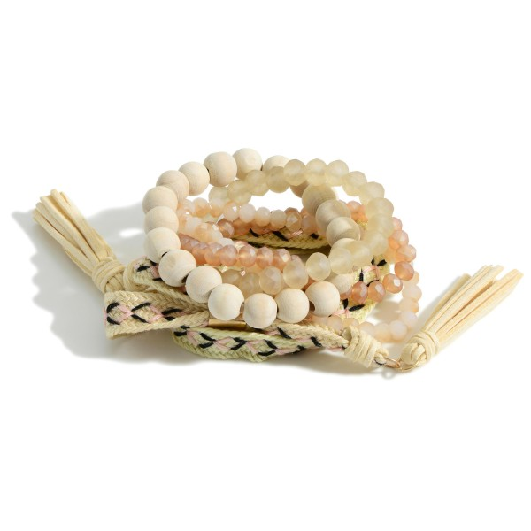 """Set of Six Bracelets Featuring Iridescent Beads, Rope Accents, and Tassel Details.   - Approximately 3"""" in Diameter"""