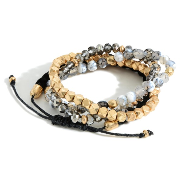"""Set of Four Beaded Bracelets Featuring Natural Stone Accents and a Faux Leather Braided Bracelet.  - Approximately 2.5"""" in Diameter"""
