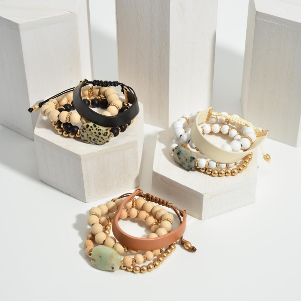 """Set of Four Bracelets Featuring Wood Beads with Gold and Faux Leather Details.   - Approximately 3"""" in Diameter"""