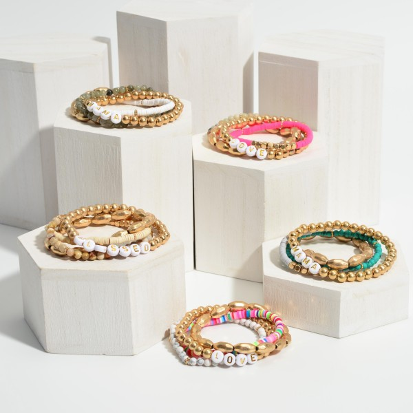 """Set of Four Bracelets Featuring Heishi Bead Accents, Gold Details, and Letter Beads that Say """"Love"""".   - Approximately 3"""" in Diameter"""