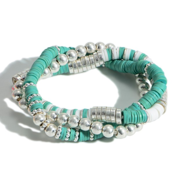 """Set of Three Beaded Bracelets Featuring Heishi Bead Accents and Silver Details.   - Approximately 3"""" in Diameter"""
