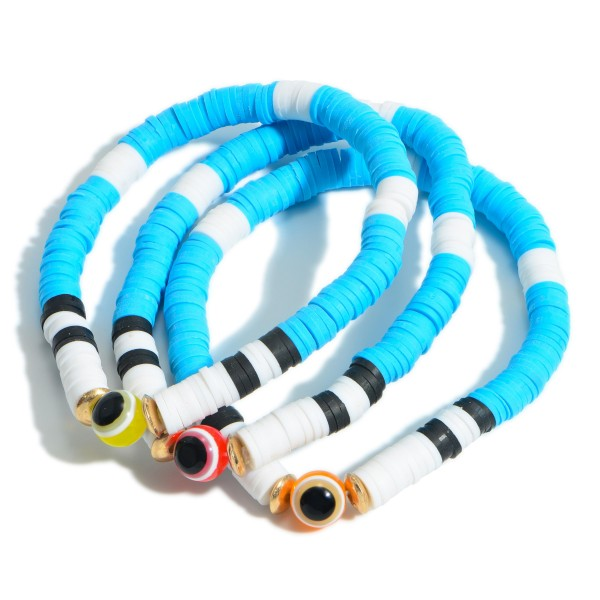 """Set of Three Heishi Bead Bracelets Featuring Evil Eye Accents.   - Approximately 3"""" in Diameter"""