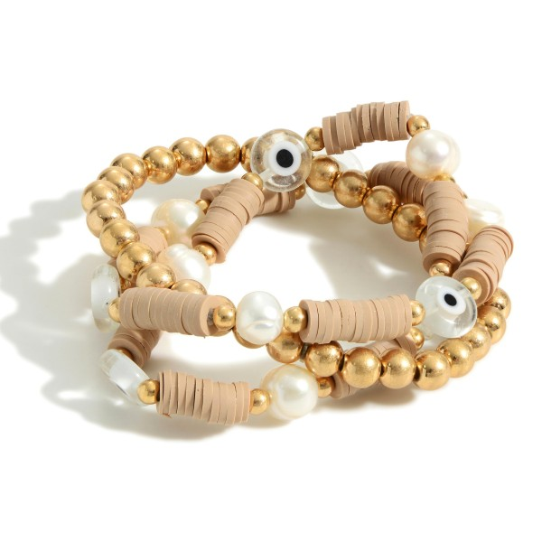 """Set of Three Heishi Bead Bracelets Featuring Evil Eye Accents.  - Approximately 2.5"""" in Diameter"""