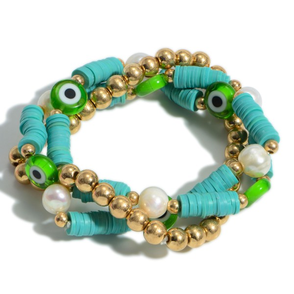 """Set of Three Bracelets Featuring Heishi Beads, Faux Pearls, and Evil Eye Accents.   - Approximately 3"""" in Diameter"""