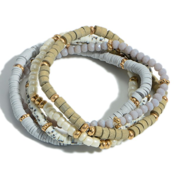 """Set of Five Beaded Bracelets Featuring Heishi Bead Accents and Gold Details.   - Approximately 3"""" Diameter"""