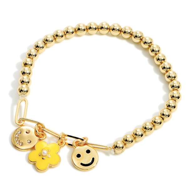 """Beaded Stretch Bracelet Featuring Floral and Smiley Face Pendant Accents.   - Approximately 3"""" in Diameter"""