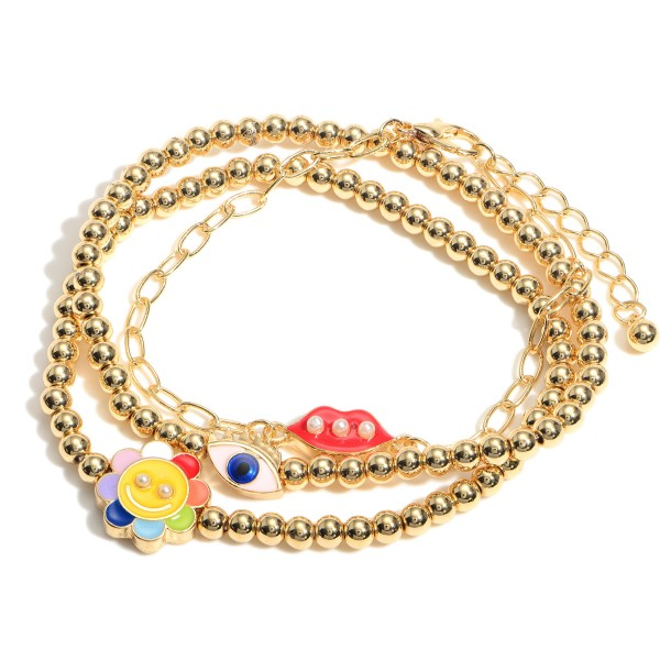 """Set of Three Metal Bracelets Featuring Evil Eye, Smiley Face, and Lips Pendants.   - Approximately 3"""" in Diameter"""