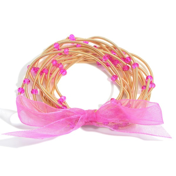 """Set of Thirteen Spring Wire Elastic Bracelets Featuring Beaded Accents.   - Approximately 3"""" in Diameter"""