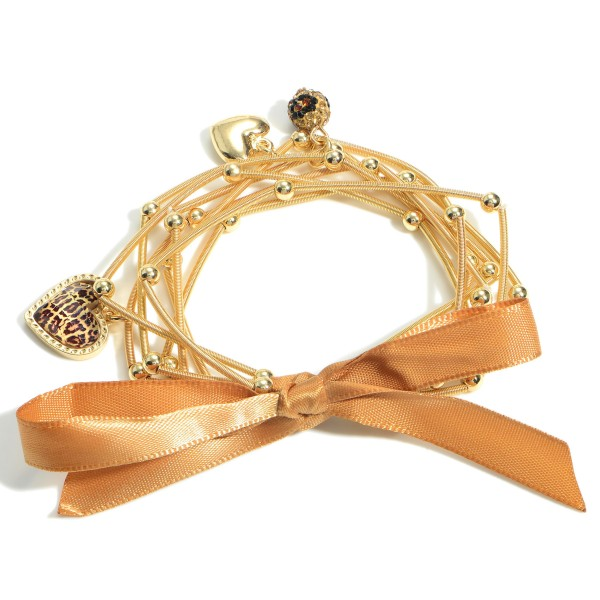 """Set of Seven Spring Wire Elastic Bracelets Featuring Leopard Print Accents and Heart Pendants.   - Approximately 3"""" in Diameter"""