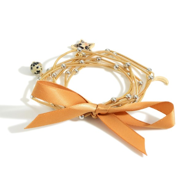 """Station Bead Cord Bracelet Featuring a Star Charm.  - Approximately 2.5"""" in Diameter"""