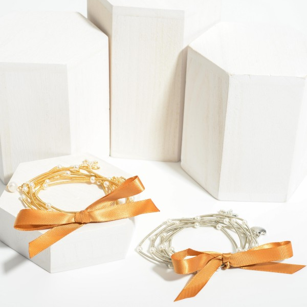 """Set of Seven Elastic Wire Bracelets Featuring Faux Pearl Accents with Seashell and Starfish Pendants.   - Approximately 3"""" in Diameter"""