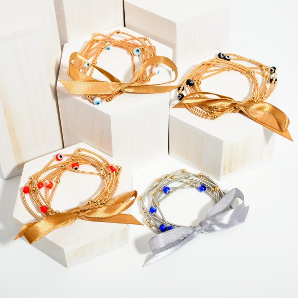 """Set of Seven Spring Wire Elastic Bracelets Featuring Evil Eye Accents.   - Approximately 3"""" in Diameter"""