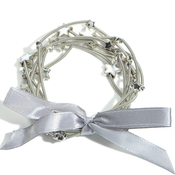 """Set of Seven Spring Wire Elastic Bracelets Featuring Star Accents.   - Approximately 3"""" in Diameter"""