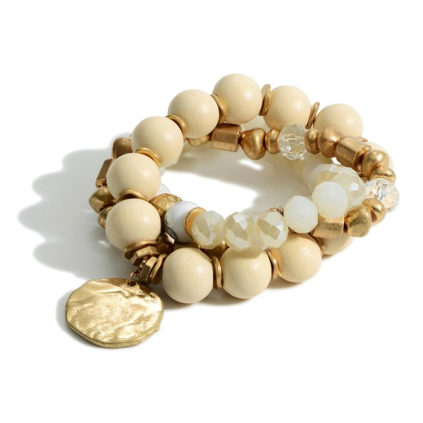 """Set of Three Beaded Bracelets Featuring Hammered Gold Pendant.   - Approximately 3"""" in Diameter"""