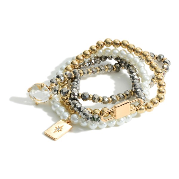 """Set of Four Bracelets Featuring Faux Pearl Accents and Gold Details.   - Approximately 3"""" in Diameter"""