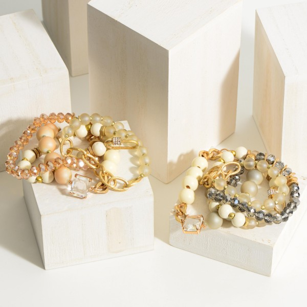 """Set of Four Beaded Bracelets Featuring Clear Crystal Accent and Gold Details.   - Approximately 3"""" in Diameter"""