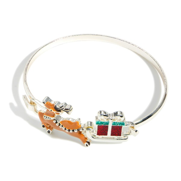 """Silver Bangle Bracelet Featuring a Reindeer Pendant.  - Approximately 2.5"""" in Diameter"""