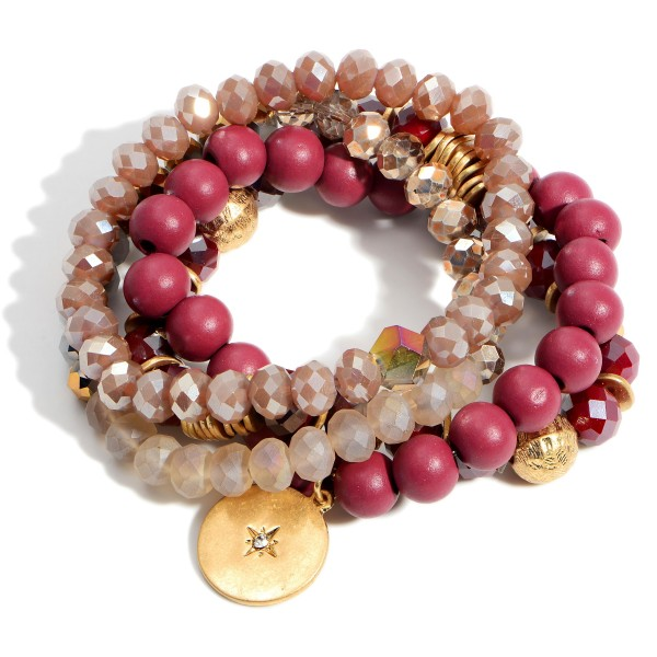 """Set of Four Beaded Bracelets Featuring Gold Accents and a Starburst Medallion.   - Approximately 2.5"""" in Diameter"""