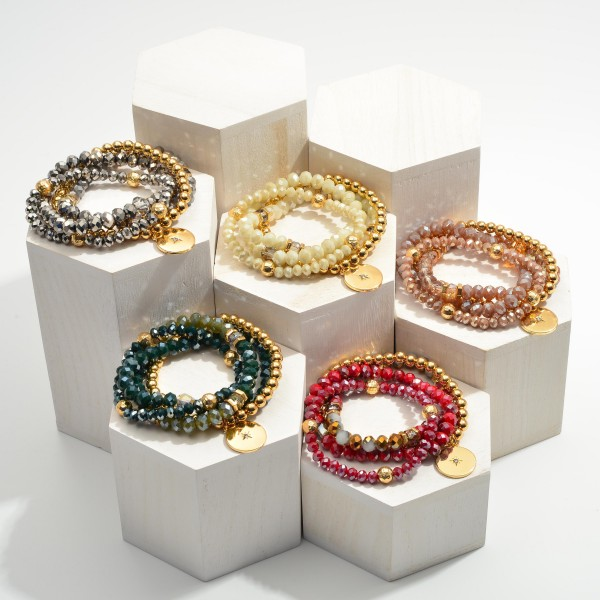 """Set of Four Beaded Bracelets Featuring Gold Accents and a CZ Starburst Medallion.  - Approximately 2.5"""" in Diameter"""